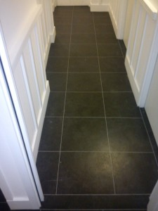 Here we have laid Black Slate Vinyl Tiles to hallway with grey grout strip to finish.