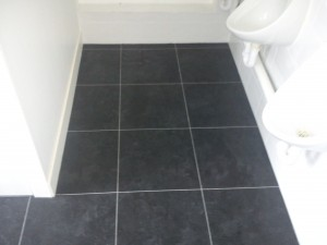 Here we have laid vinyl tiles to the mens toilets. This choice of tile allows the floor to be hygenic and have a modern appearance.